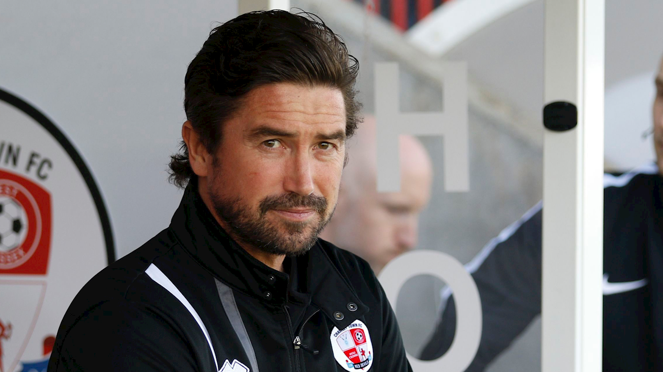Harry Kewell in the Crawley dugout