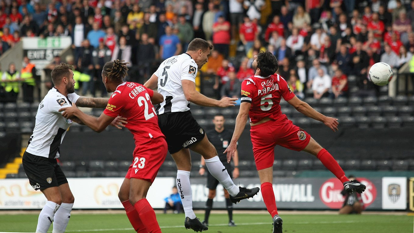 Notts central defender Ben Turner sees his header cleared off the line from a corner..jpg