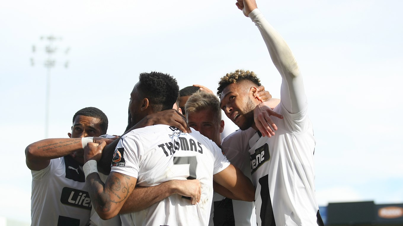 Kyle Wootton celebrates with team mates after putting Notts ahead..jpg