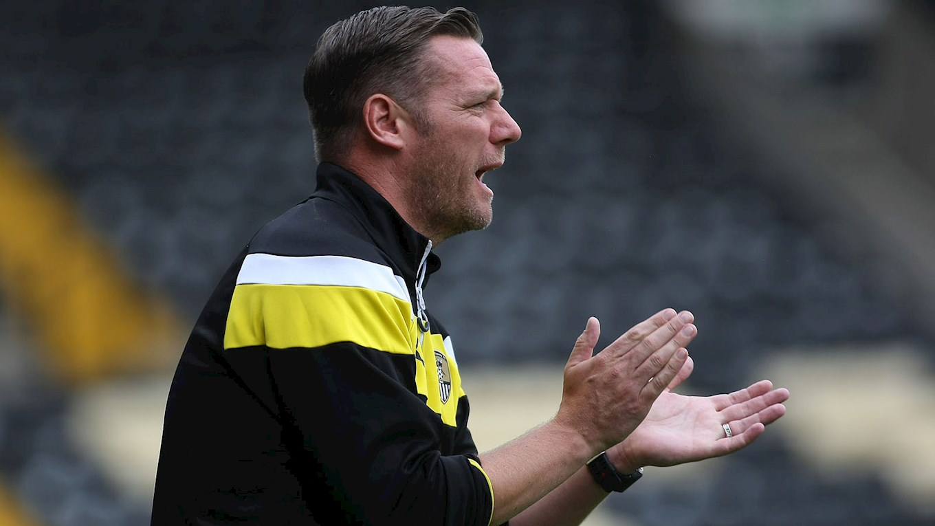 Kevin Nolan encourages his team against Wigan